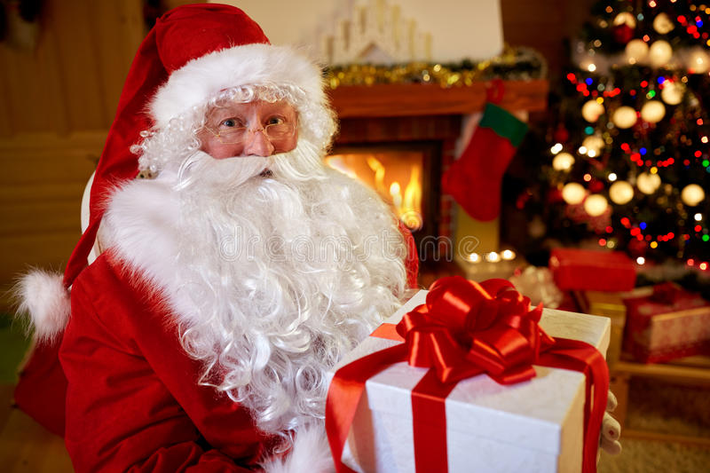 Portrait Santa Claus with gift for you. On Christmas stock images