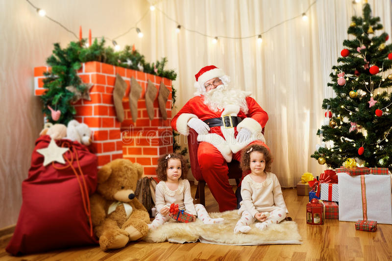 Portrait of Santa Claus and girl twin babies,child in the room b stock image