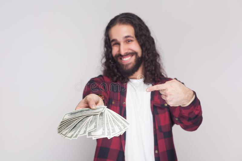 Portrait of satisfied happy young businessman in red checkered s royalty free stock images
