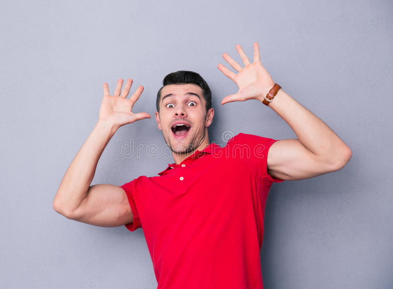 Portrait of a scared casual man stock photo