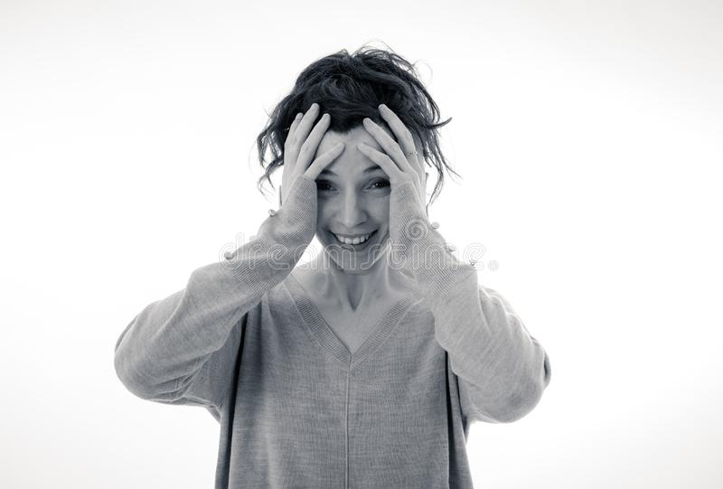 Portrait of scared and intimidated woman. Isolated on white. Human expressions and emotions stock image