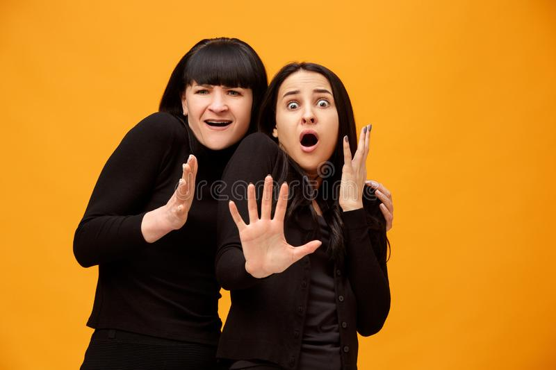 A portrait of a scared mother and daughter royalty free stock images