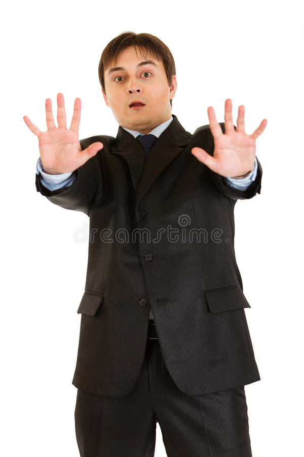 Portrait of scared young businessman royalty free stock photo