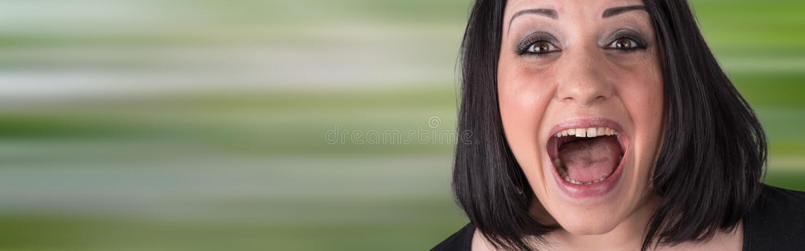 Portrait of a scared young woman royalty free stock image