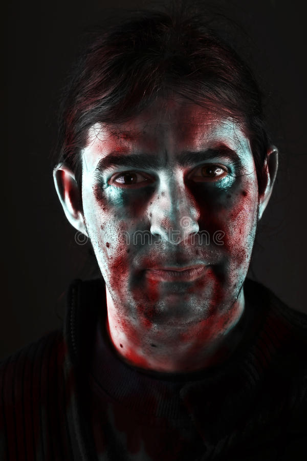 portrait of scary bad zombie looking at camera for theme halloween stock photo