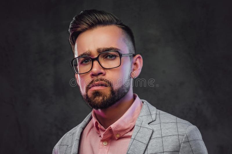 Portrait of sceptical proud man in checkered blazer, pink shirt and glasses. Portrait of sceptical proud man in checkered  blazer, pink shirt and glasses royalty free stock photo