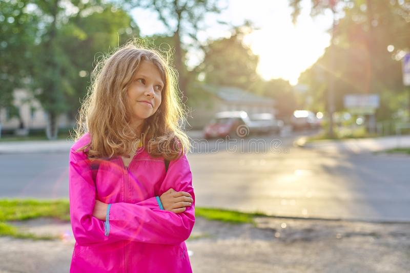 Portrait of school girl in jacket with backpack stock photos