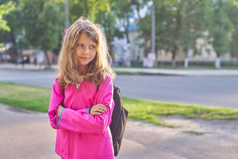 Portrait of school girl in jacket with backpack royalty free stock photo