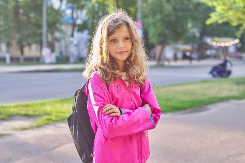 Portrait of school girl in jacket with backpack royalty free stock image