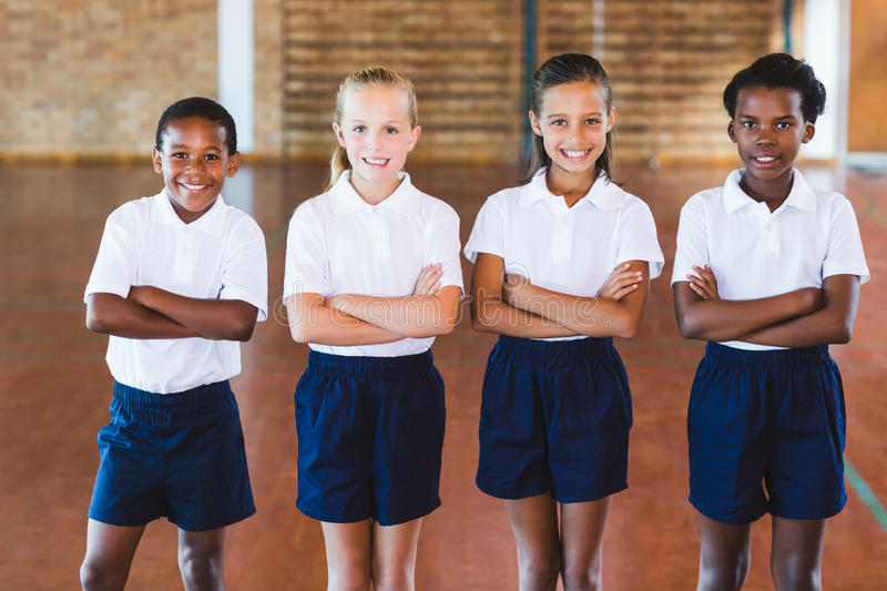 Portrait of school kids standing with arms crossed stock image