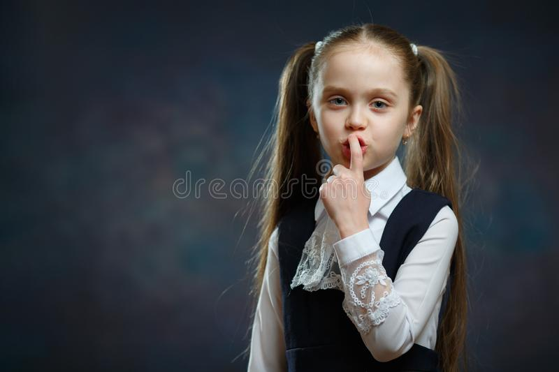 Portrait of Schoolgirl Show Keep Silence Sign royalty free stock photo