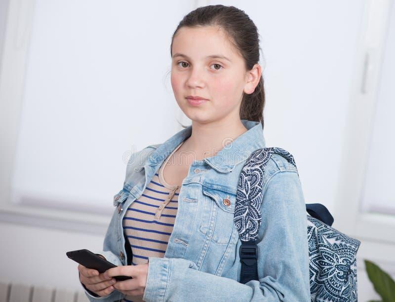 Portrait of schoolgirl using phone stock image
