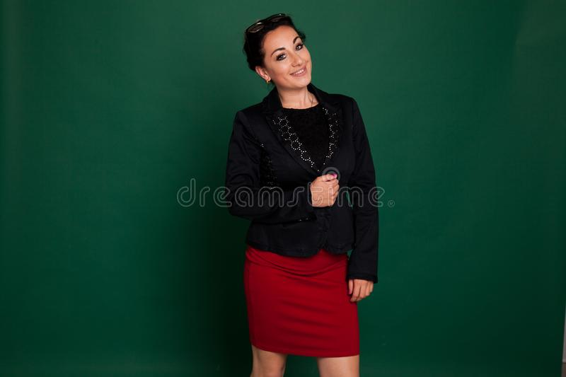 Portrait of a schoolteacher at a green board royalty free stock image
