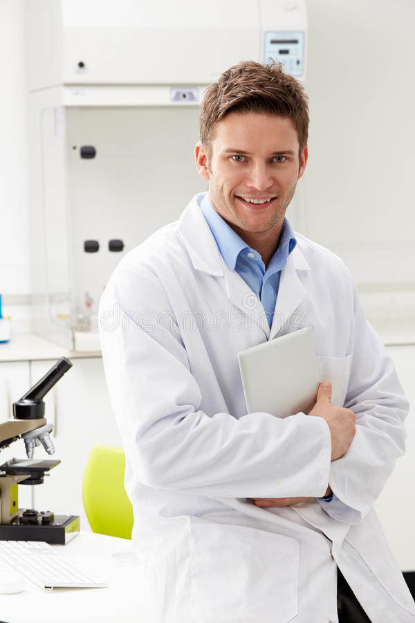 Portrait Of Scientist With Clipboard In Laboratory royalty free stock photos
