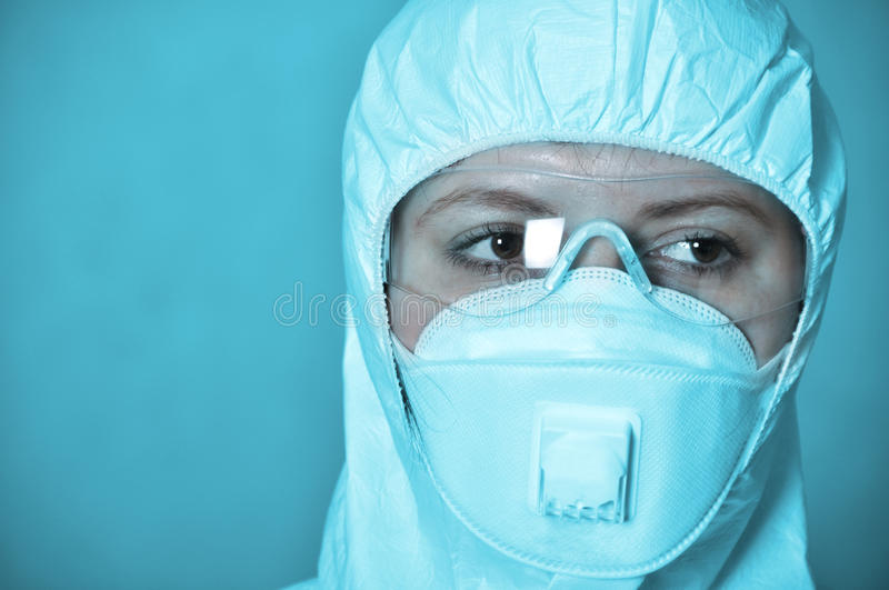Portrait of scientist in protective wear. On blue background stock photo