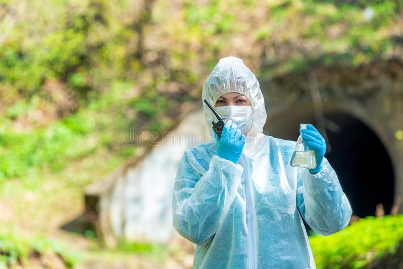 portrait of a scientist with a water sample from the sewer royalty free stock photos