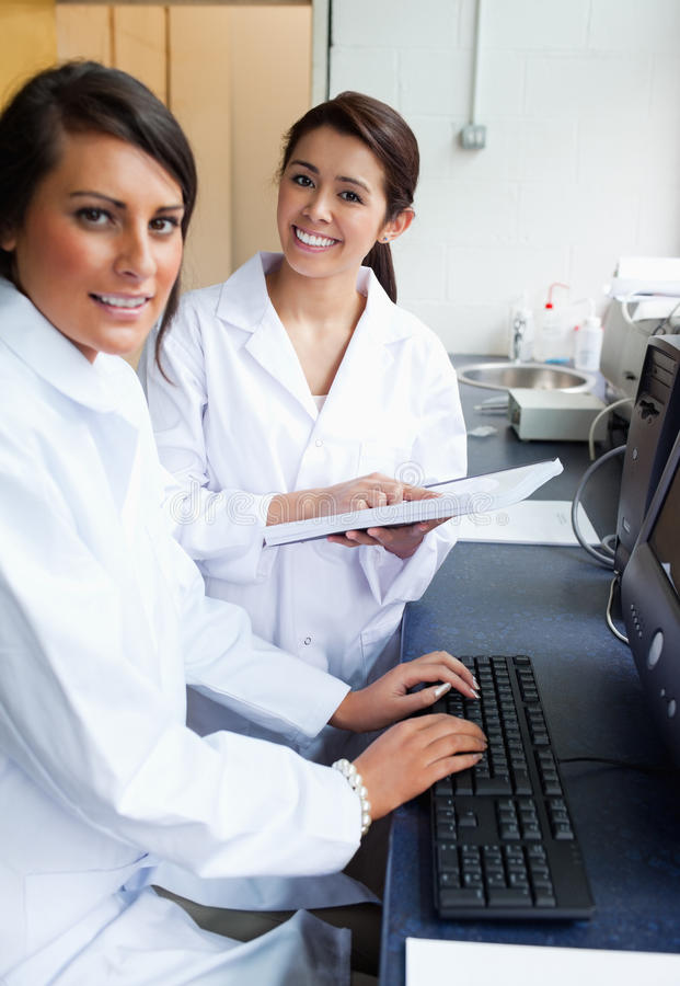 Download Portrait Of Scientists Posing With A Monitor Stock Image - Image: 21146537