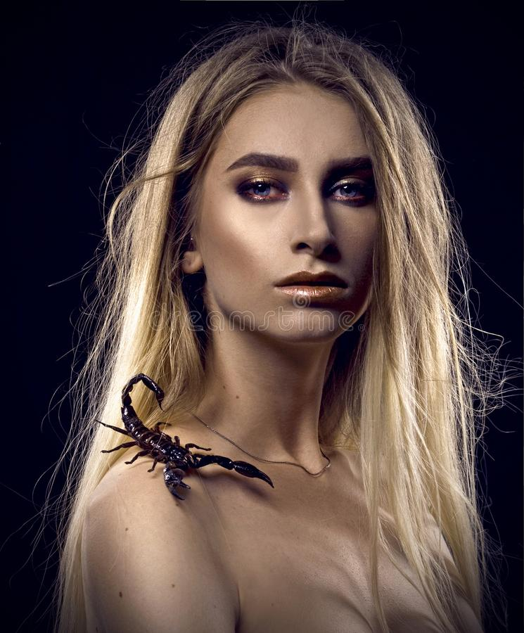 Portrait with a scorpion royalty free stock photography