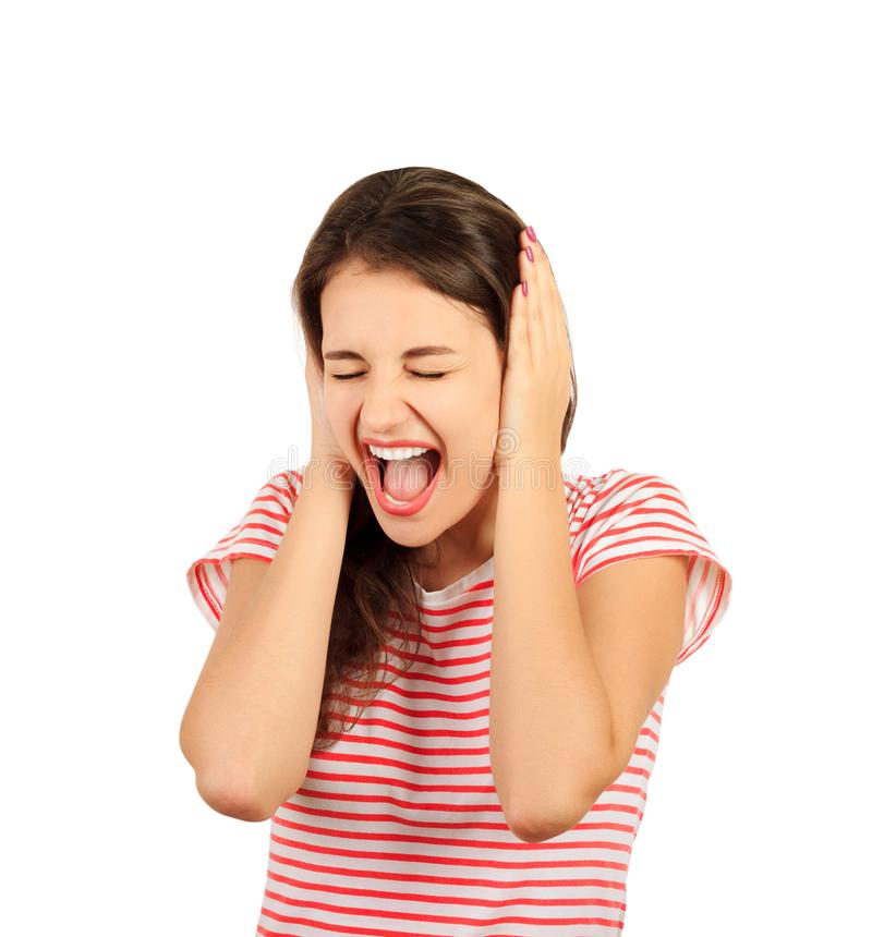 Portrait of screaming female face squeeze her ears by hand. emotional girl isolated on white background stock photo