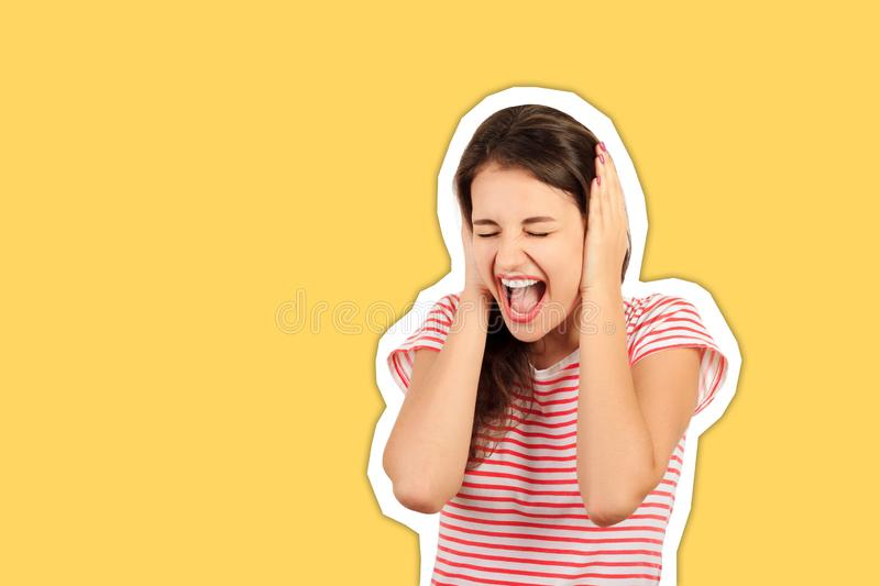 Portrait of screaming female face squeeze her ears by hand. emotional Magazine collage style with trendy color royalty free stock images
