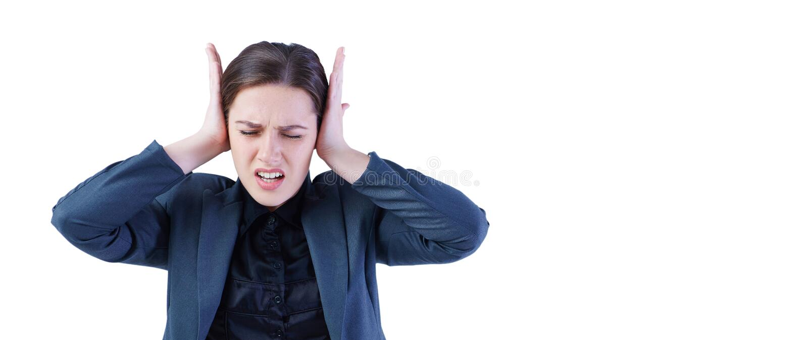Portrait of young screaming female face squeeze her ears by hand - isolated on white. royalty free stock images
