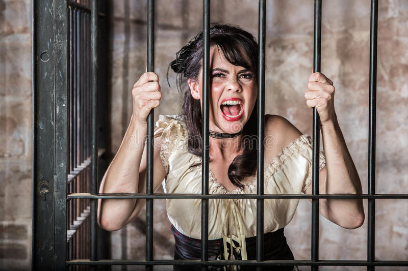 Portrait of Screaming Female Prisoner stock photo
