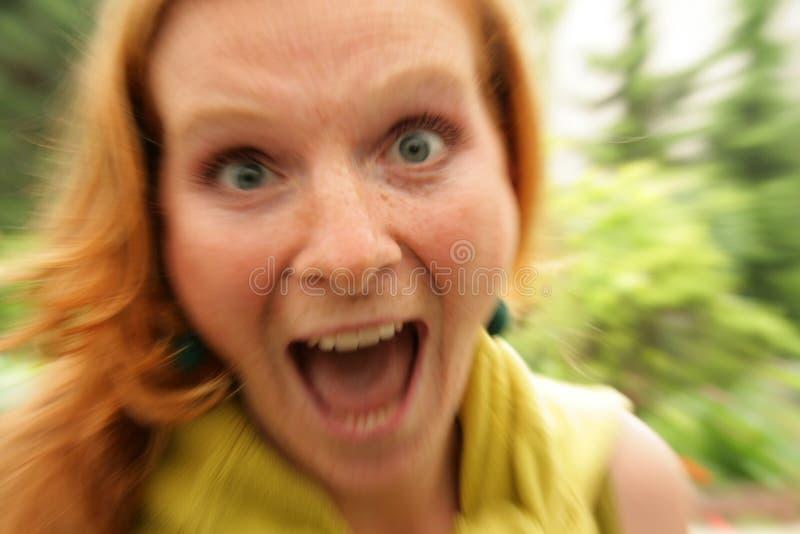 Portrait of screaming redhead girl