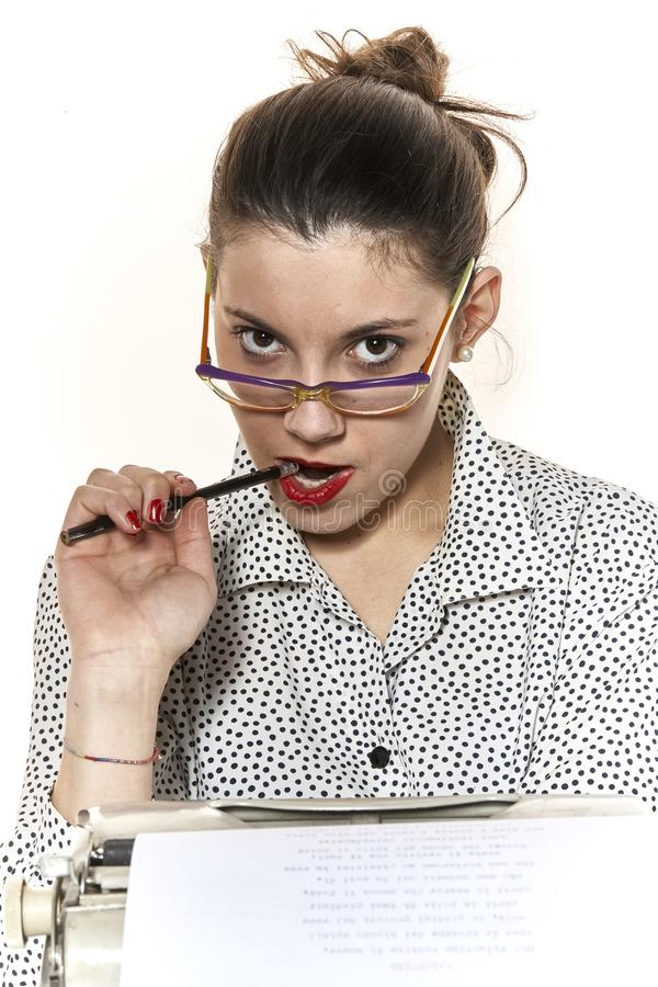 Portrait of a secretary, or a teacher, while she bites a pen stock images