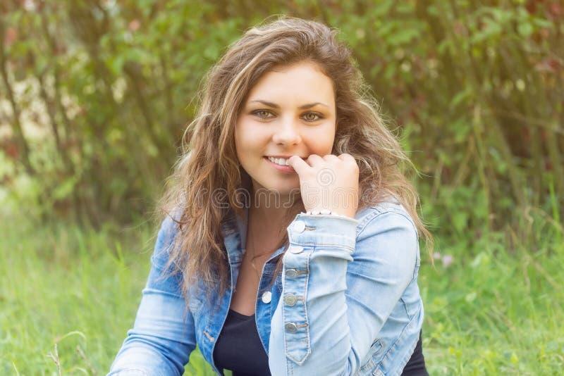 Portrait of seducing smiling teenage girl stock photo