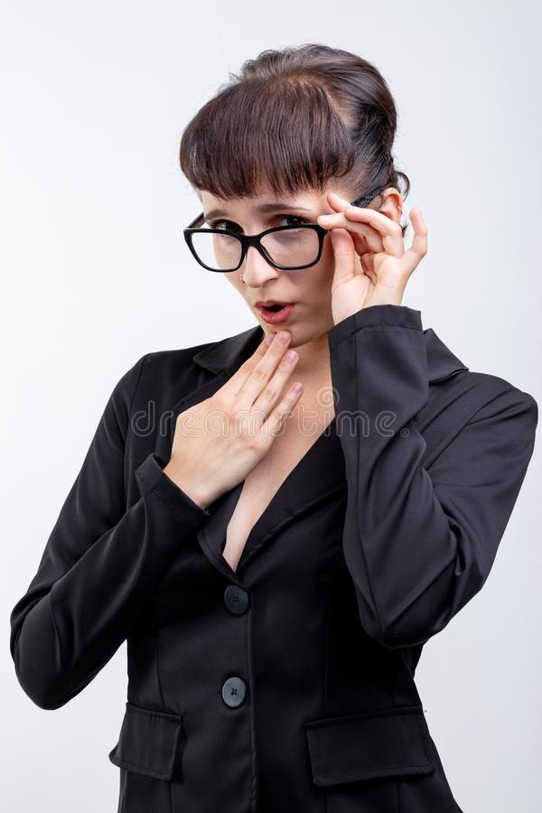 Portrait of seductive office woman with glasses. Portrait of a seductive office woman wearing glasses on a white background with copy space royalty free stock photography