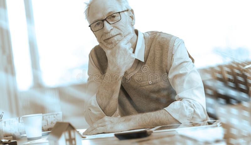 Portrait of senior architect; light effect stock image