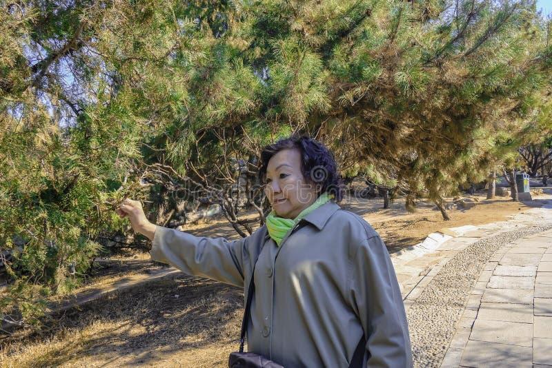 Portrait senior asian women at Summer palace park in beijing. Portrait senior asian woman at Summer palace park in beijing China royalty free stock images
