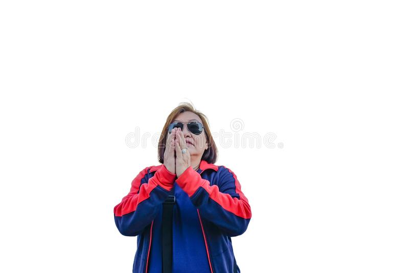 Portrait of Senior asian women prayer position. Portrait of Senior asian woman prayer position on isolated background stock image