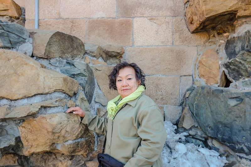 Portrait senior asian women with the rock stone at Summer palace beijing. Portrait senior asian woman with the rock stone at Summer palace beijing China stock images