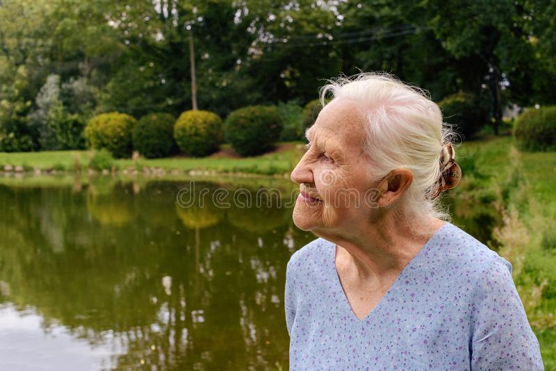 Elderly woman outdoor portrait stock photo