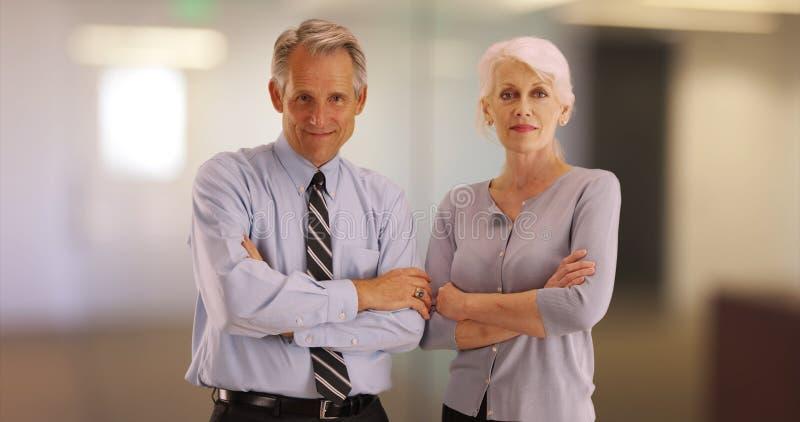 Portrait of senior business professionals smiling at camera.  stock image
