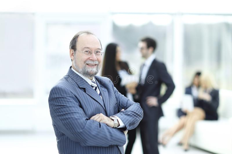 Portrait of a senior businessman on blurred background office stock image
