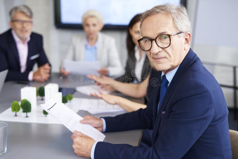 Portrait of senior businessman during a conference royalty free stock photos