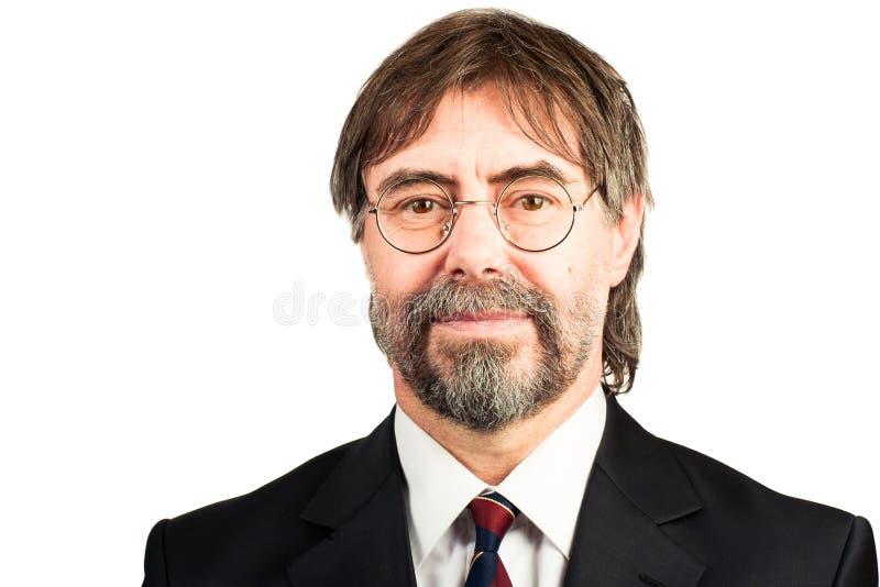 Portrait of a senior businessman smiling stock image