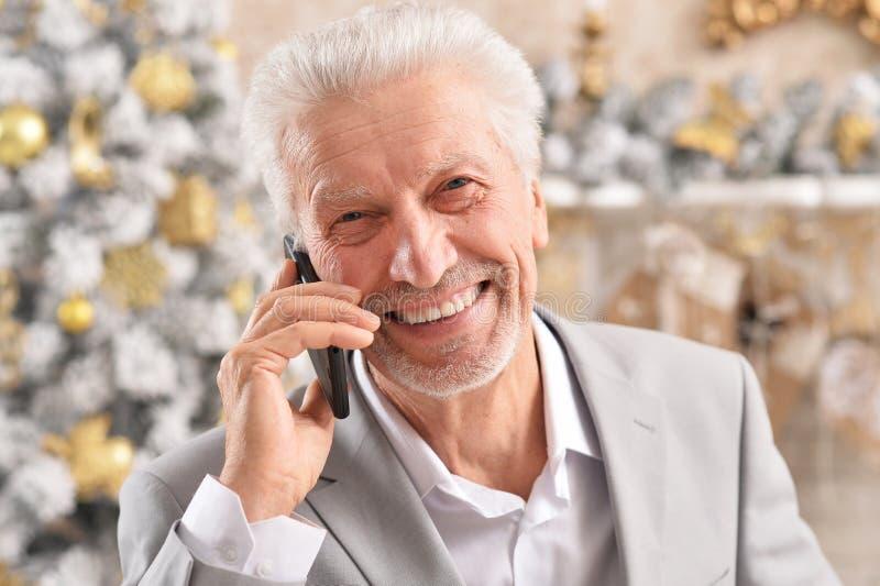 Portrait of senior businessman talking on phone royalty free stock image