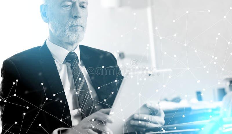 Portrait of senior businessman working on tablet. light effect. Portrait of senior businessman working on tablet at office. light effect stock photography