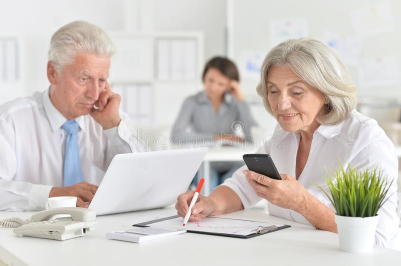 Portrait of a senior businesspeople working in the office stock photography