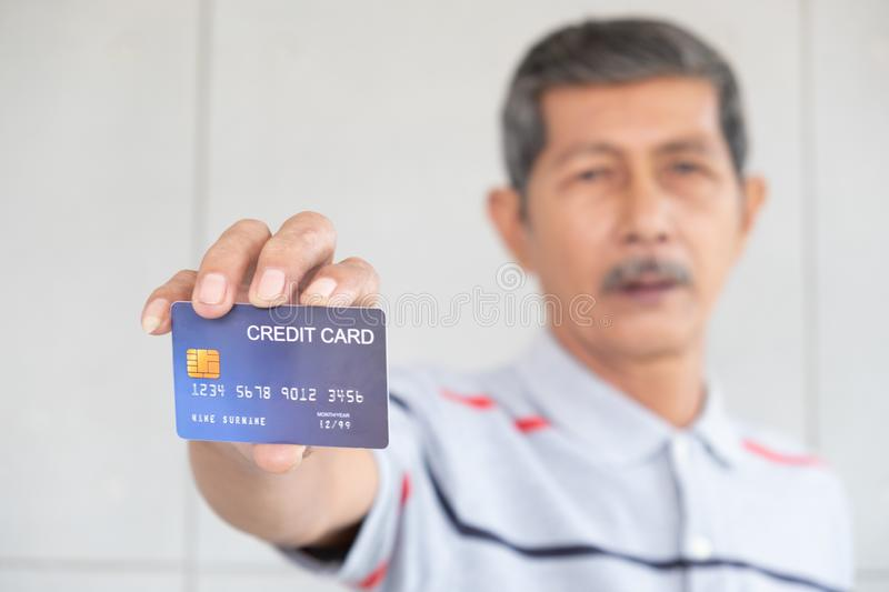 Portrait of senior bussiness men and show credit card stock images