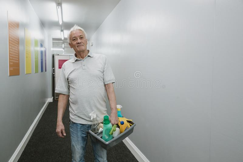 Portrait of a Senior Cleaner stock image