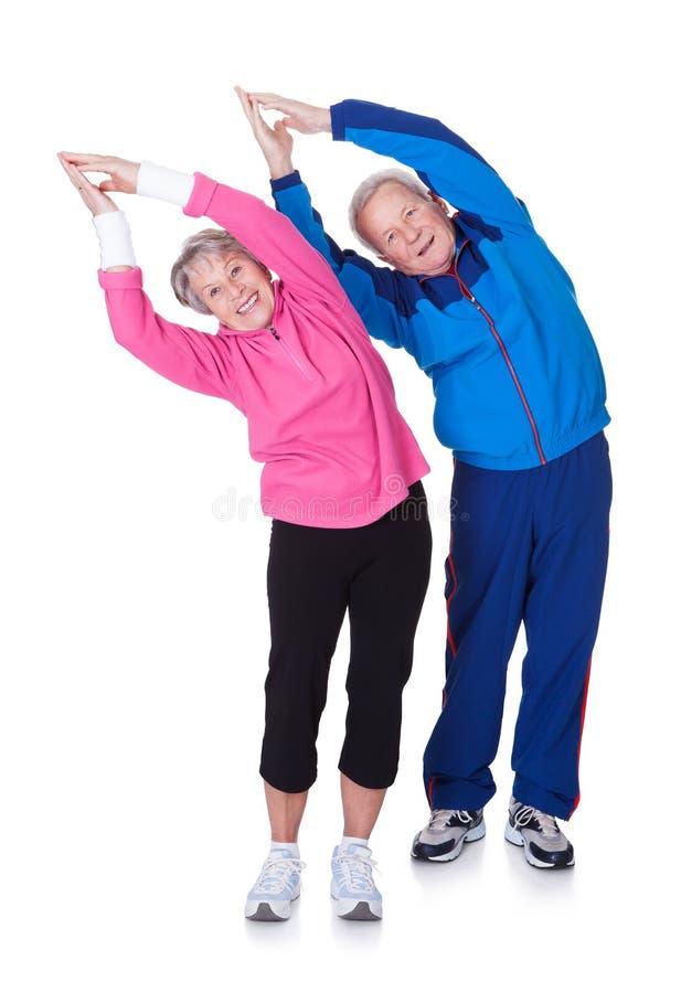 Portrait of a senior couple exercising stock photos