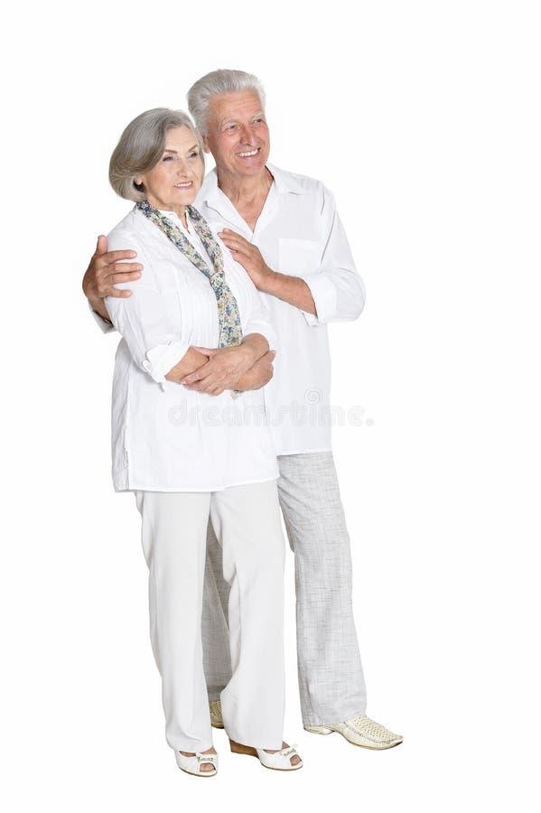 Portrait of senior couple hugging on white background royalty free stock images