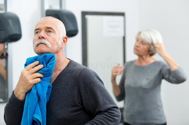 Portrait senior couple in locker-room before gym royalty free stock image