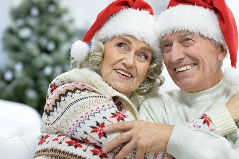Portrait of senior couple in Santa hats royalty free stock photo