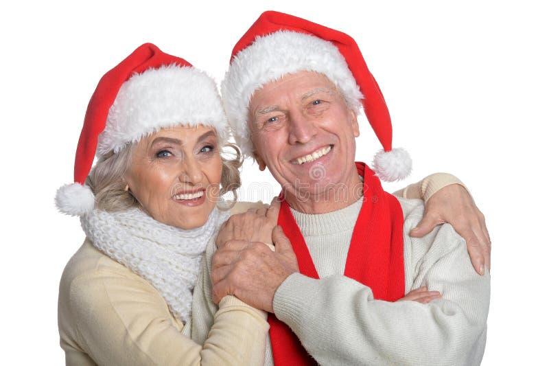 Portrait of senior couple in Santa hats stock photos