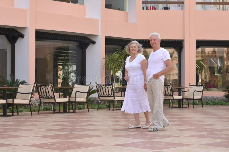 Senior couple at hotel resort. Portrait of senior couple at tropic hotel resort royalty free stock images